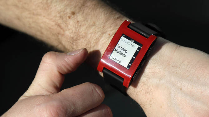 Eric Migicovsky, CEO of Pebble, displays his company's smart watch in Palo Alto, Calif., Tuesday, Feb. 12, 2013.  These new watches not only tell time, but also connect to smart phones within 10 meters. (AP Photo/Marcio Jose Sanchez)