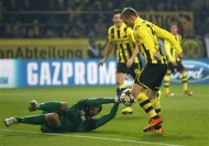 Borussia Dortmund's Jakub Blaszczykowski (R) scores a goal against Shakhtar Donetsk during the Champions League soccer match in Dortmund March 5, 2013. REUTERS/Ina Fassbender