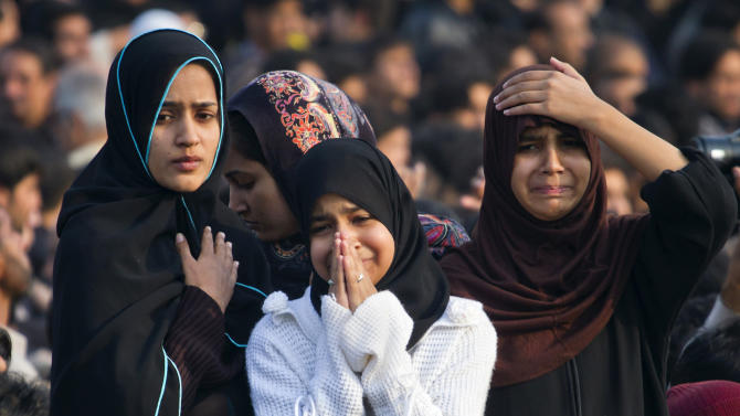Pakistani Shiite Muslim girls mourn during a Muharram procession in Islamabad, Pakistan, Saturday, Nov. 24, 2012. Muharram is a month of mourning in remembrance of the martyrdom of Imam Hussein, the grandson of Prophet Mohammed. (AP Photo/Anjum Naveed)