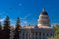Space shuttle Endeavour and its carrier aircraft fly low over the California State Capitol Building in Sacramento on Sept. 21, 2012, during a state-wide tour over California on the way to Los Angeles, where Endeavour will be placed on public di