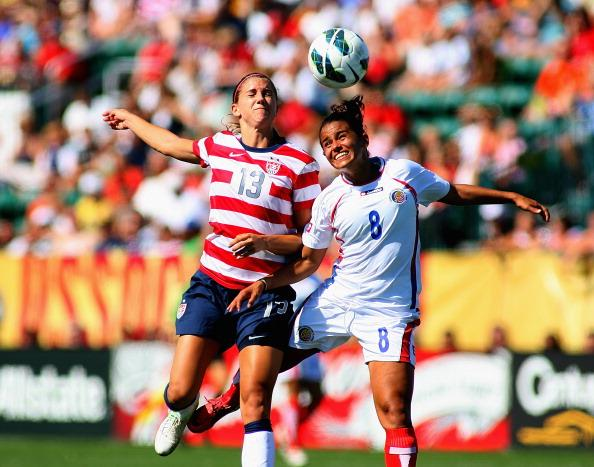 Alex Morgan #13 of the United States Womens National Team attacks against Daniela Cruz #8 of Costa Rica during their friendly match at Sahlen's Stadium on September 1, 2012 in Rochester, New York. The