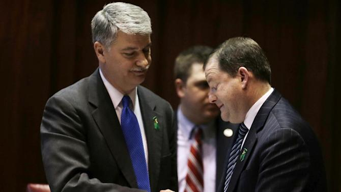 Senate Minority Leader John McKinney, R-Fairfield, who represents Newtown, Conn., right, and Senate President Donald Williams, D-Brooklyn, shake hands after the passage of a gun-control bill in the Senate chamber at the Capitol in Hartford, Conn., Wednesday, April 3, 2013. The bill passed the Senate and goes onto the Conn. Houses for approval. Hundreds of gun rights advocates are gathering at the statehouse in Hartford ahead of a vote in the General Assembly on proposed gun-control legislation. (AP Photo/Charles Krupa)