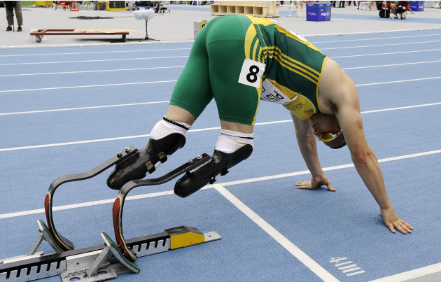 South Africa's Oscar Pistorius lines up on the starting blocks ahead of aheat of the Men's 400m at the World Athletics Championships in Daegu, South Korea, Sunday, Aug. 28, 2011. (AP Photo/Martin Meis