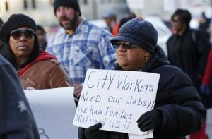 Detroit city worker Geraldine Gilmore protests against the city's municipal bankruptcy filing, outside the Federal courthouse in Detroit