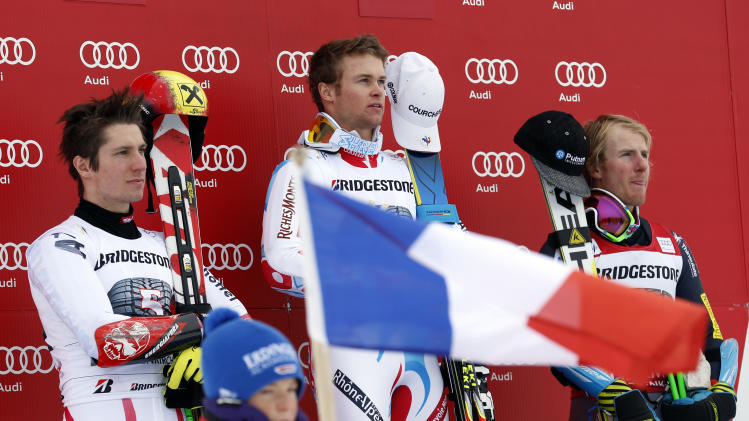 France's Alexis Pinturault, center, winner of an alpine ski, men's world cup giant slalom, listens to the national anthem with second-placed Marcel Hirscher, of Austria, left, and third-placed Ted Ligety, of the United States, in Garmisch-Partenkirchen, Germany, Sunday, Feb. 24, 2013. (AP Photo/Alessandro Trovati)