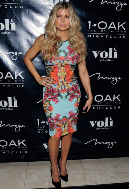 Celebrity fashion: Fergie wore a colour clashing dress to celebrate her birthday in Las Vegas and we're not so sure it works. The pink and orange floral print compete with the bright blue shade, this