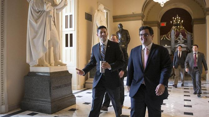 House Speaker Paul Ryan of Wis., center, walks to the House chamber on Capitol Hill in Washington, Friday, Feb. 12, 2016, as Republicans and Democrats joined together to overwhelmingly approve legislation that hits North Korea with more stringent sanctions for refusing to stop its nuclear weapons program.   (AP Photo/J. Scott Applewhite)