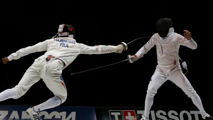 Robeiri of France competes against Park Kyoung-doo of South Korea in the men's team epee final match at the World Fencing Championships in Kazan
