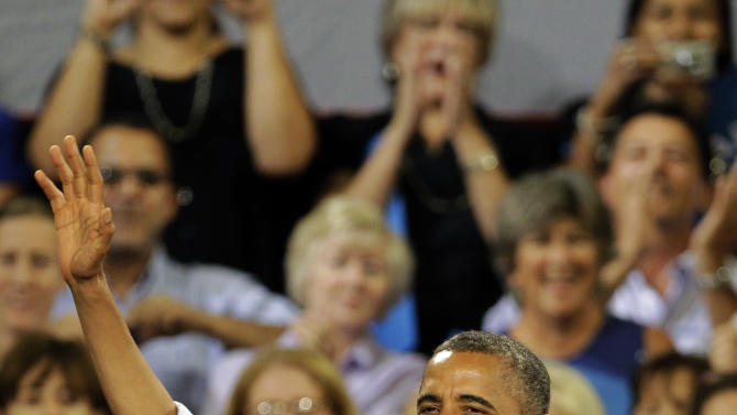 President Barack Obama waves to supporters as he arrives at a campaign event, Sunday, Sept. 9, 2012, in Melbourne, Fla. (AP Photo/John Raoux)