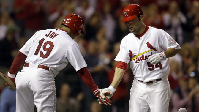 St. Louis Cardinals' Jaime Garcia, right, is congratulated by teammate Jon Jay after hitting a solo home run during the third inning of a baseball game against the Cincinnati Reds, Monday, Oct. 1, 2012, in St. Louis. (AP Photo/Jeff Roberson)