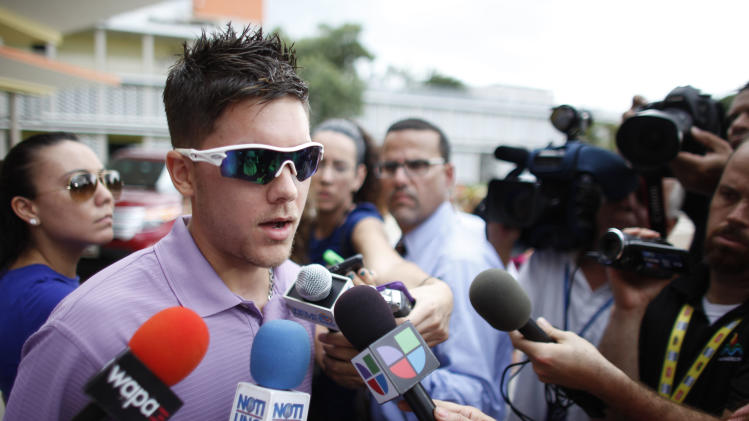 "Hector ""Macho"" Camacho's son-in-law, Widniel Adorno, talks to reporters about the condition of his father-in-law, in San Juan, Puerto Rico, Wednesday, Nov. 21, 2012. The former boxing champion was clinging to life Wednesday after being shot in the face while in a car in his hometown of Bayamom. Doctors and his family expected to decide whether to remove Camacho from life support. His condition worsened overnight and his heart stopped at one point, said Dr. Ernesto Torres, director of the Centro Medico trauma center in San Juan. (AP Photo/Ricardo Arduengo)"