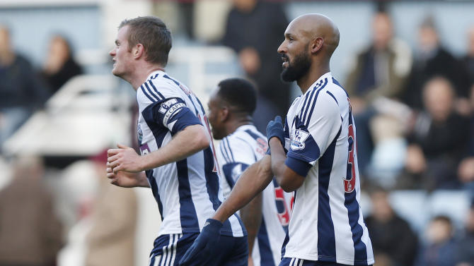 "FILE - This is a Saturday, Dec. 28, 2013. file photo of West Bromwich Albion's Nicolas Anelka, right, as he gestures to celebrates his goal against West Ham United during their English Premier League soccer match at Upton Park, London. It's caught on like a dance move one hand pointing downward, the other touching the shoulder with arm across the chest. But for many, the gesture is a hateful, anti-Semitic code. France's top security official wants the entertainer who popularized it banned from the stage. Dieudonne M'Bala M'Bala, who has performed for more than two decades and has a small but faithful following, contends the gesture, dubbed the quenelle, is no more than an anti-system sign, the equivalent of ""shove it."" Soccer star Nicolas Anelka used it on Saturday Dec. 28to celebrate a goal, and basketball star Tony Parker did likewise. Both said they did not understand it was an anti-Semitic gesture. Parker said in his mea culpa contained in a statement released by the San Antonio Spurs that he ""thought it was part of a comedy act."" (AP Photo/Sang Tan, File)"