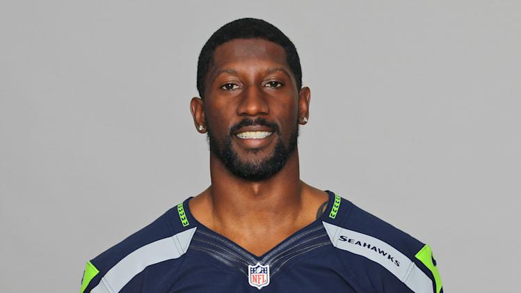 This is a 2012 file photo showing Marcus Trufant of the Seattle Seahawks NFL football team. The Seahawks have signed former cornerback Marcus Trufant, who is expected to announce his retirement from football.  Seattle announced the signing Wednesday and said Trufant was expected to announce his intentions during a news conference Thursday, April 24, 2014.  (AP Photo)