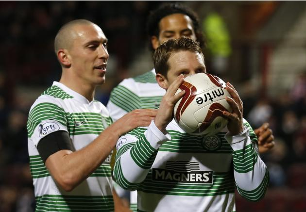 Celtic's Commons celebrates his third goal against Heart of Midlothian during their Scottish Cup fourth round soccer match at Tynecastle stadium, Edinburgh