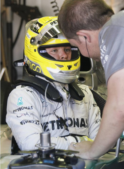 Mercedes Formula One driver Nico Rosberg of Germany speaks with a mechanic during the second practice session of the Monaco F1 Grand Prix