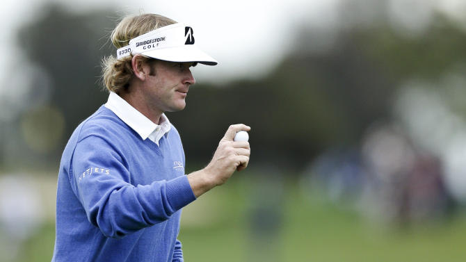 Brandt Snedeker acknowledges the gallery on the third green on the North Course at Torrey Pines during the first round of the Farmers Insurance Open golf tournament Thursday, Jan. 24, 2013 in San Diego. (AP Photo/Gregory Bull)