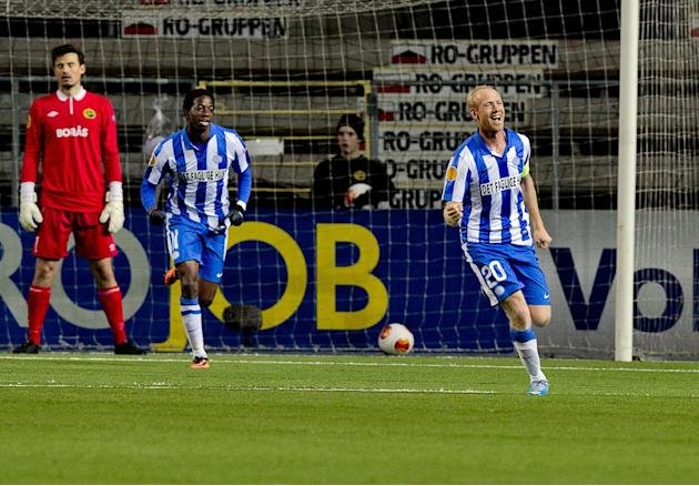 Esbjerg's Hans Henrik Andreasen, right, celebrates scoring with teammate Mushaga Bakenga as Elfsborg's goalkeeper Kevin Stuhr-Ellegaard, left, looks on during the group C Europa League soccer match at