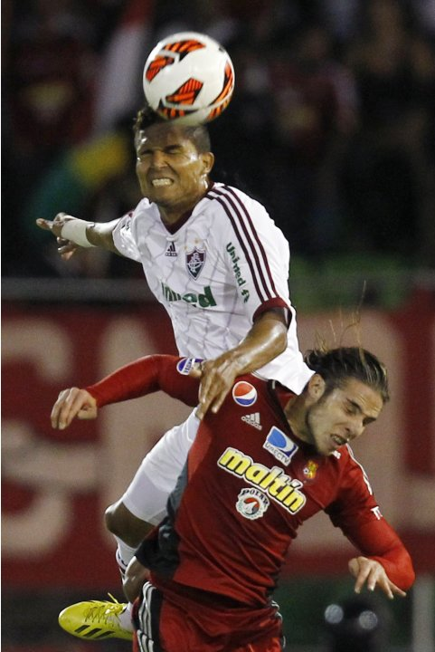 Febles of Venezuela's Caracas FC challenges Jean of Brazil's Fluminense during their Copa Libertadores soccer match in Caracas