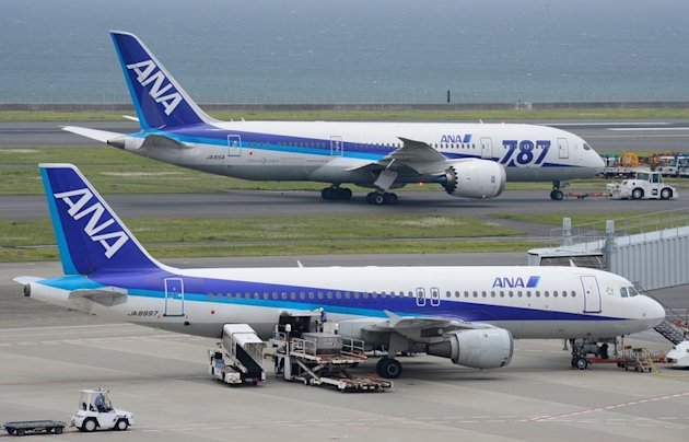 A Dreamliner passenger plane (top) from Japan's All Nippon Airways (ANA) at Haneda Airport in Tokyo on April 30, 2013