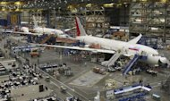 787 Dreamliners, including an airplane for Air India (R), are seen on the production line at the Boeing Commercial Airplane manufacturing facility in Everett, Washington February 14, 2011.  REUTERS/Anthony Bolante
