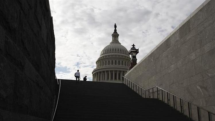Late-afternoon visitors climb a stairway outside the U.S. Capitol in Washington, September 28, 2013. REUTERS/Jonathan Ernst