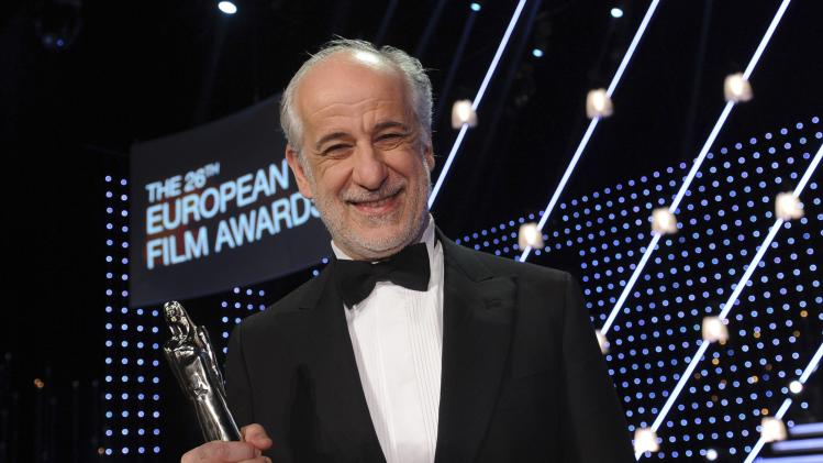Italian actor Servillo poses with his trophy for Best Actor after the European Film Awards ceremony in Berlin