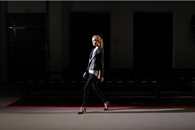 A model walks during a rehearsal before the presentation of Belgian designer Cedric Charlier Fall-Winter 2013/2014 women's ready-to-wear fashion collection during Paris fashion week