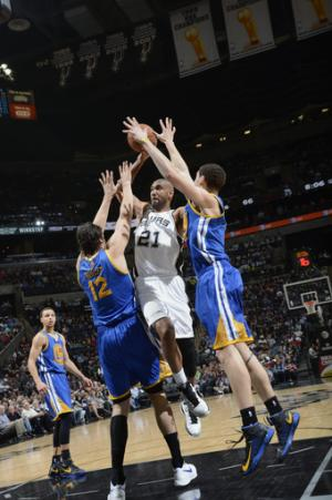 Duncan leads Spurs past Warriors 104-93