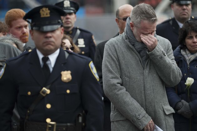 William Macko, Jr. wipes tears from his eyes as mourners and family members of victims participate in a memorial for victims of 1993 bombing of the World Trade Center in New York