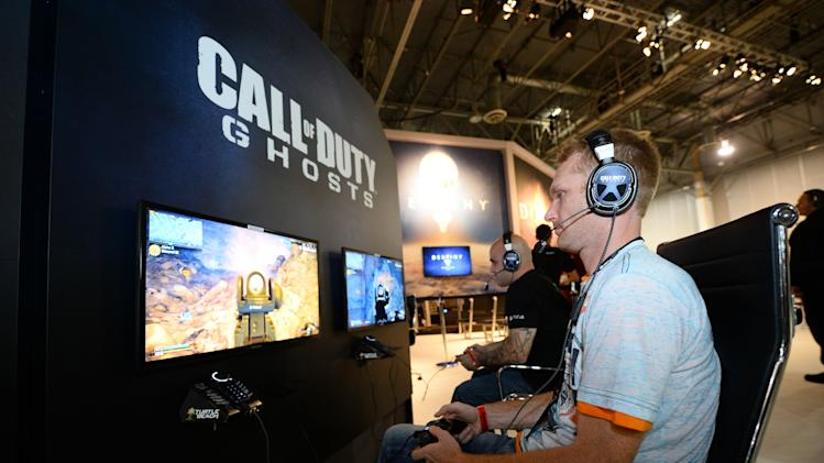 "An attendee plays ""Call of Duty: Ghosts"" at the GameStop Expo in Las Vegas on Wednesday, Aug. 28, 2013. (Photo by Al Powers/Invision/AP)"