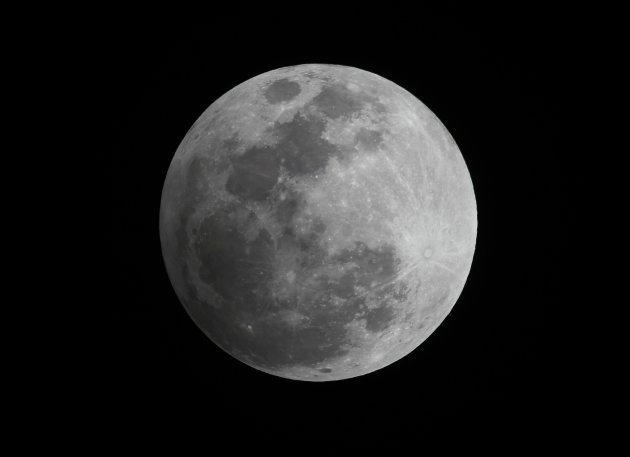 A penumbral eclipse of the moon is seen in the night sky in Manila November 28, 2012. The Philippine Atmospheric, Geophysical, and Astronomical Services Administration (PAGASA) said a penumbral refers to a partially shaded outer region of a shadow that an object casts and occurs when the moon passes through the faint penumbral portion of the earth's shadow. The penumbral eclipse of the moon will also be observed in Europe, East Africa, Asia, Australia, Pacific and North America. REUTERS/Romeo Ranoco (PHILIPPINES - Tags: SOCIETY SCIENCE TECHNOLOGY ENVIRONMENT)