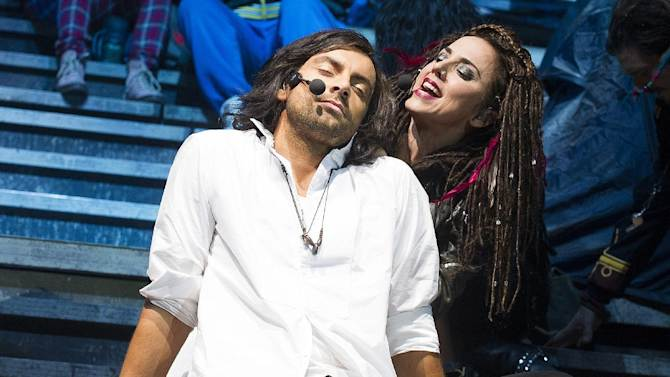 "This undated image released by Boneau/Bryan-Brown shows Ben Forster as Jesus Christ, left, and former Spice Girls member Melanie Chisholm, as Mary Magdalene, in ""Jesus Christ Superstar"" currently touring in London. ""Jesus Christ Superstar UK Rock Spectacular"" will be shown at hundreds of movie theaters across America on Oct. 29 and again on Nov. 1. The show was recorded on Oct. 4-5 in Birmingham, England.  (AP Photo/Boneau/Bryan-Brown, Tristram Kenton)"