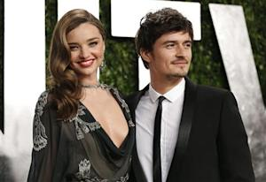 Orlando Bloom (R) and Miranda Kerr at the 2013 Vanity Fair Oscars Party in West Hollywood