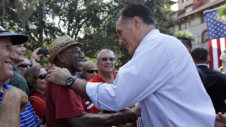 Republican presidential candidate, former Massachusetts Gov. Mitt Romney greets Thomas and Patricia Evans, of St. Mary's, Ga., during a campaign event at Flagler college, Monday, Aug. 13, 2012, in St. Augustine, Fla.  (AP Photo/Mary Altaffer)