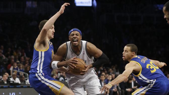 Nets stop Warriors' streak at 10, win 102-98