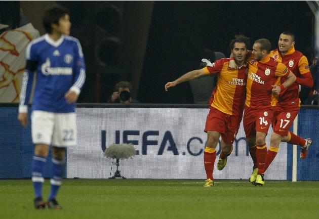 Galatasaray's players celebrate a goal against Schalke 04 during the Champions League soccer match in Gelsenkirchen