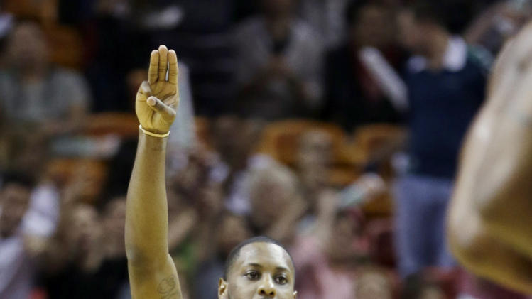 Miami Heat's Mario Chalmers (15) celebrates after scoring a three-pointer against the Indiana Pacers during the second half of an NBA basketball game in Miami, Sunday, March 10, 2013. The Heat won 105-91. (AP Photo/Alan Diaz)