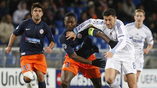 Montpellier&#39;s Mapou Yanga-Mbiwa (L) challenges Schalke 04&#39;s Ciprian Marica during their Champions League  match at Stade de la Mosson stadium in Montpellier