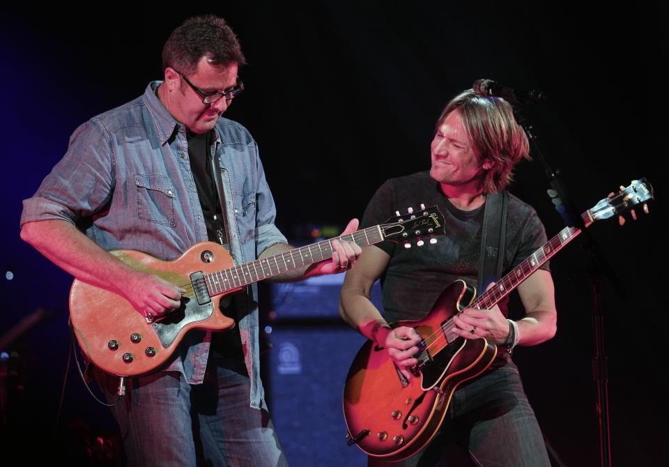 Vince Gill, left, and Keith Urban perform during the All for the Hall concert on Tuesday, April 10, 2012, in Nashville, Tenn. The concert is a benefit for the Country Music Hall of Fame and Museum. (AP Photo/Mark Humphrey)