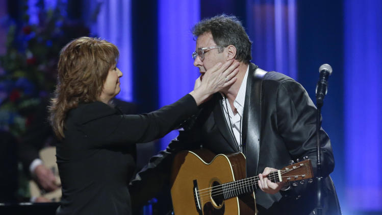 Patty Loveless embraces Vince Gill, right, after they performed during the funeral for country music star George Jones in the Grand Ole Opry House on Thursday, May 2, 2013, in Nashville, Tenn. Jones, one of country music's biggest stars who had No. 1 hits in four separate decades, died April 26.  (AP Photo/Mark Humphrey, Pool)
