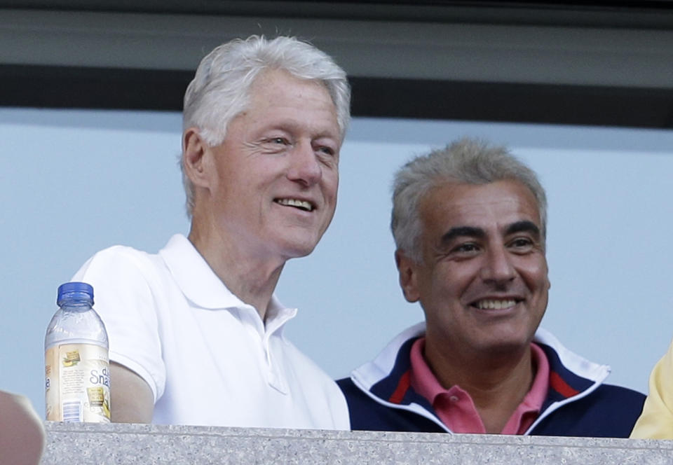 Former president Bill Clinton, left, watches play between Victoria Azarenka, of Belarus, and Serena Williams during the women's singles final of the 2013 U.S. Open tennis tournament, Sunday, Sept. 8, 2013, in New York. (AP Photo/Darron Cummings)