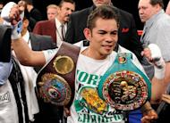 Filipino boxing star Nonito Donaire, seen here here in February 2011 after he stopped Fernando Montiel to take two world bantamweight titles, has signed a deal with Oscar de la Hoya's Golden Boy Promotions