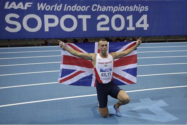 Britain's Richard Kilty celebrates winning the gold after the men's 60m final during the Athletics Indoor World Championships in Sopot, Poland, Saturday, March 8, 2014