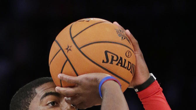 Kyrie Irving of the Cleveland Cavaliers shoots during the 3-point contest during NBA basketball All-Star Saturday Night, Feb. 16, 2013, in Houston. (AP Photo/Eric Gay)