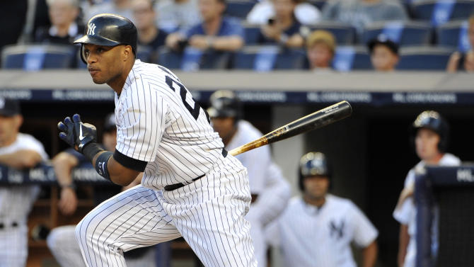 New York Yankees' Robinson Cano starts a rally of 12 run scored in the first inning against the Baltimore Orioles with an RBI single in the second baseball game of a doubleheader, Saturday, July 30, 2011, at Yankee Stadium in New York. The Yankees set a franchise record for runs in the first inning. (AP Photo/Kathy Kmonicek)
