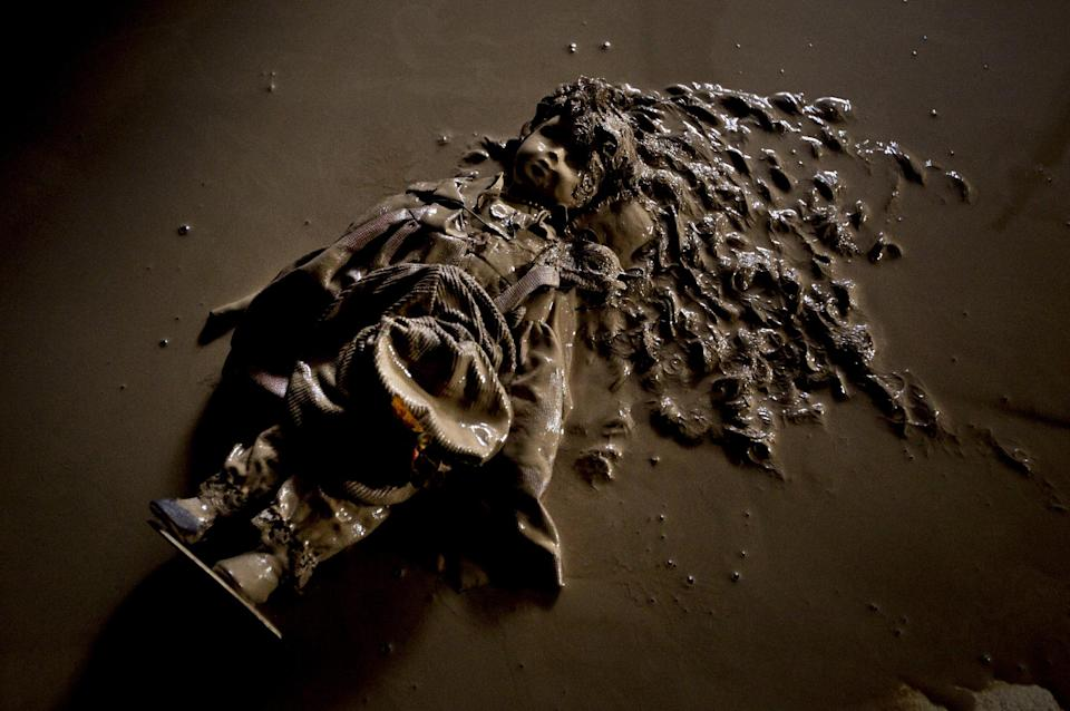 A doll covered with mud lies on the floor after a flood hit the village of Bat Hefer, central Israel, Wednesday, Jan. 9, 2013. About 200 homes were flooded and tens of cars were damaged by the flood. (AP Photo/Ariel Schalit)