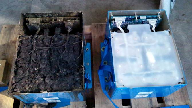 """This Jan. 17, 2013 photo provided by the Japan Transport Safety Board shows the distorted main lithium-ion battery, left, and an undamaged auxiliary battery of the All Nippon Airways' Boeing 787 which made an emergency landing on Jan. 16, 2013 at Takamatsu airport in Takamatsu, western Japan.   An investigation into the battery that overheated on a Boeing 787 flight in Japan found evidence of the same type of """"thermal runaway"""" seen in a similar incident in Boston, officials said Tuesday, Feb. 5, 2013. (AP Photo/Japan Transport Safety Board, File) EDITORIAL USE ONLY, NO SALES"""
