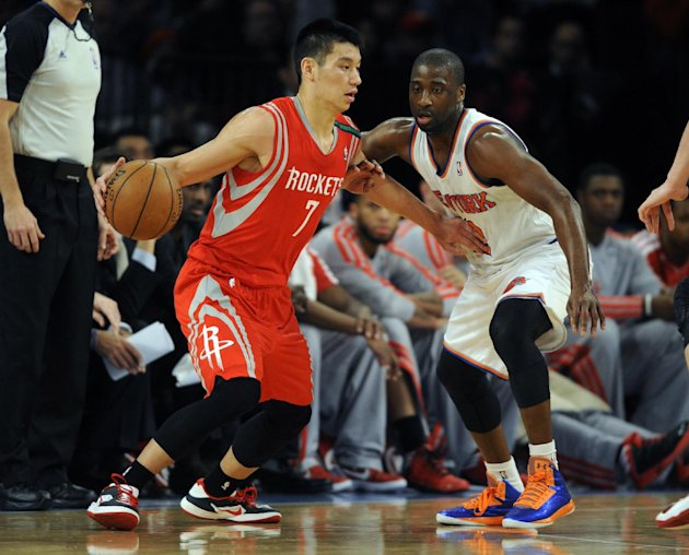Houston Rockets' Jeremy Lin, left, drives on New York Knicks' Raymond Felton in the first quarter of an NBA basketball game at Madison Square Garden in New York, Monday, Dec. 17, 2012. (AP Photo/Henny