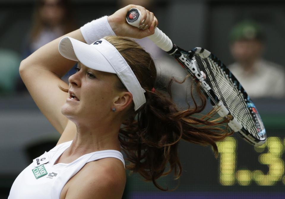 Agnieszka Radwanska of Poland plays a return to Angelique Kerber of Germany during a semifinals match at the All England Lawn Tennis Championships at Wimbledon, England, Thursday, July 5, 2012. (AP Photo/Anja Niedringhaus)