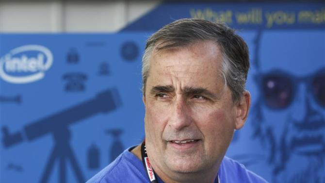 Intel CEO Brian Krzanich speaks with an Intel employee at the Maker's Faire in San Mateo
